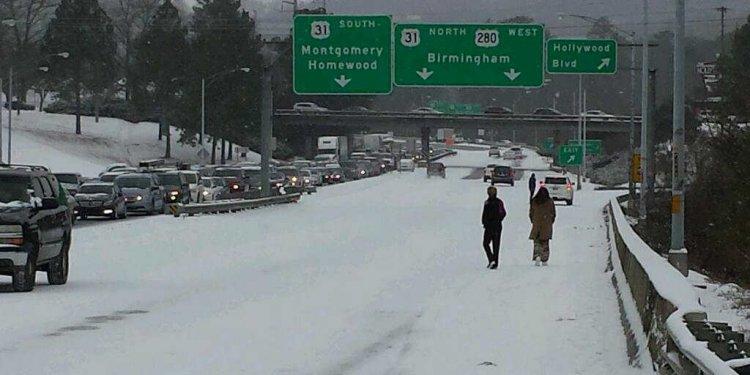 People walk along Highway 280